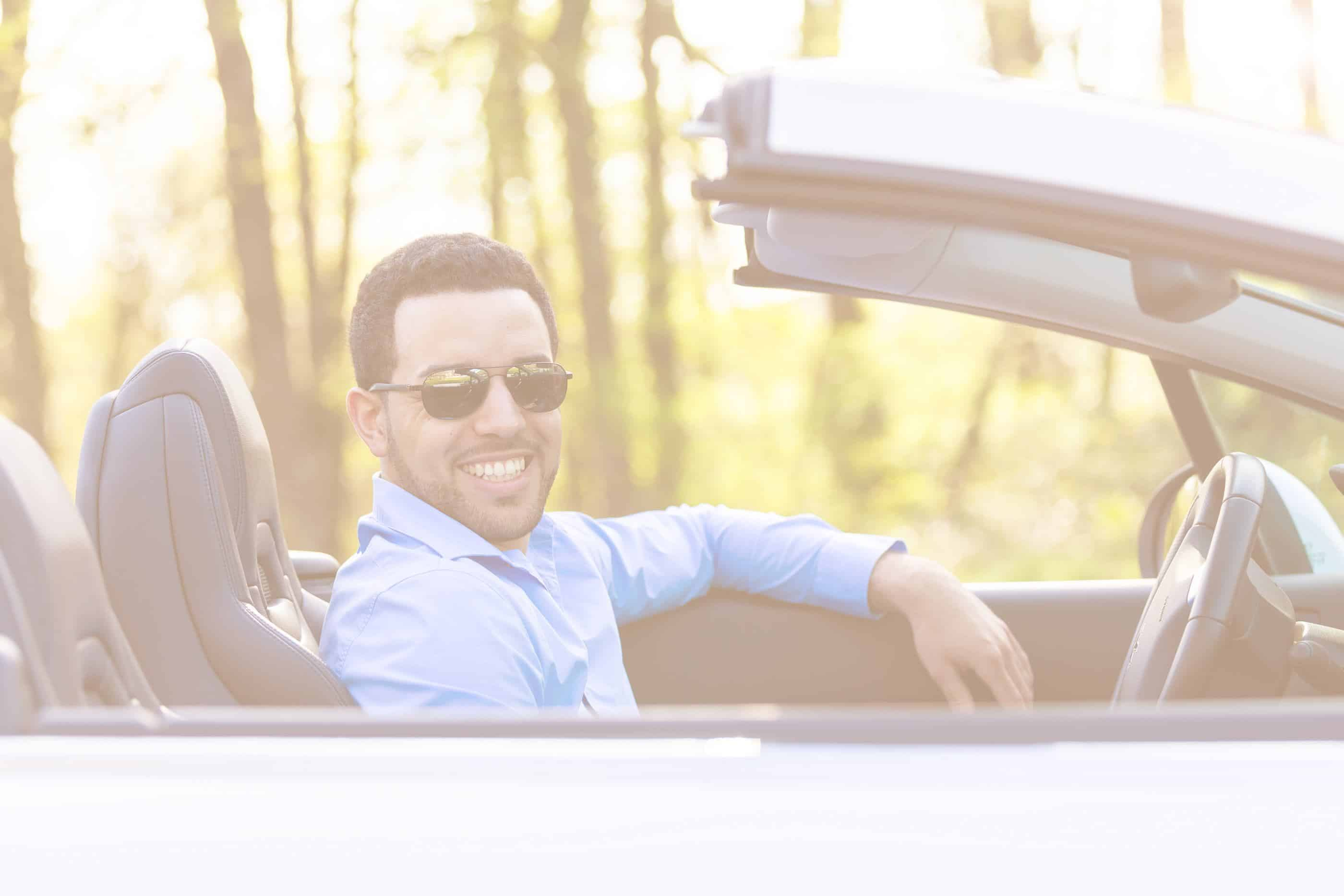 Man driving a convertible